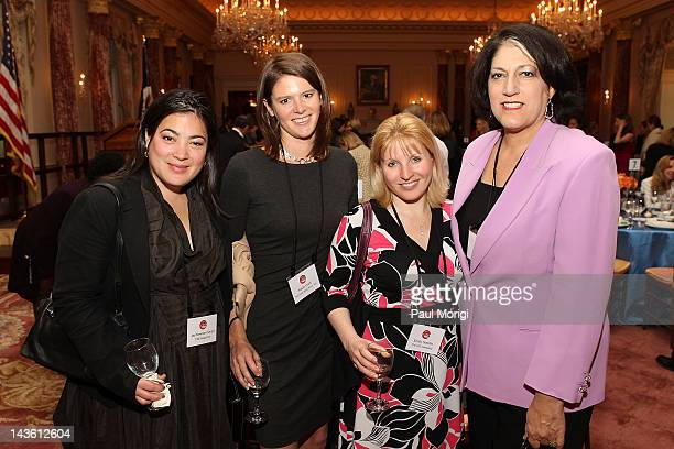 Jay NewtonSmall Kasie Hunt Emily Goodin and Tammy Haddad pose for a photo at FORTUNE Most Powerful Women Dinner at US Department Of State's Benjamin...