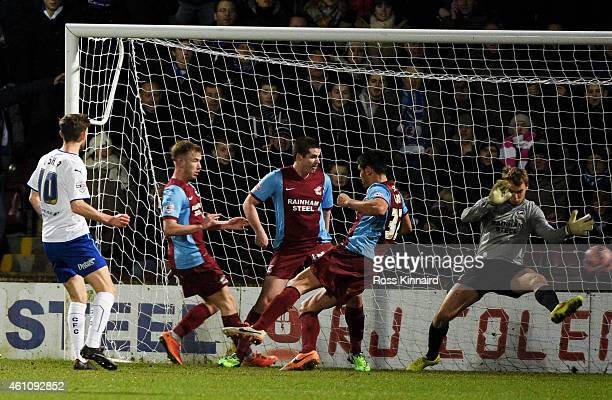 Jay O'Shea of Chesterfield scoes a goal to level the scores at 2-2 during the FA Cup Third Round match between Scunthorpe United and Chesterfield FC...