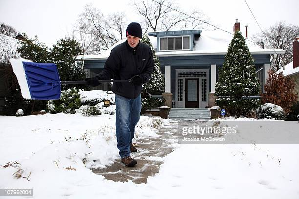 Jay Patton shovels off the walkway to his home in the Inman Park neighborhood after a snow storm on January 10 2011 in Atlanta Georgia Atlanta Mayor...