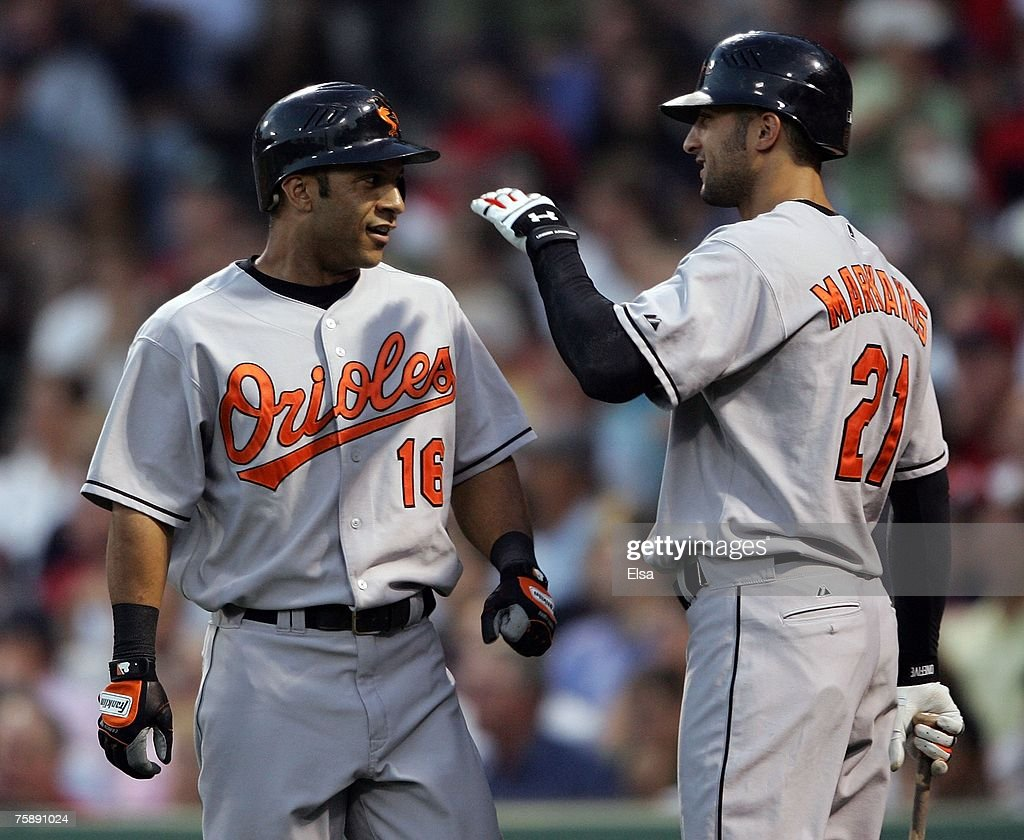Jay Payton #16 of the Baltimore Orioles is congratulated by teammate Nick Markakis #21 after Payton scored in the third inning against the Boston Red Sox on July 31, 2007 at Fenway Park in Boston, Massachusetts.