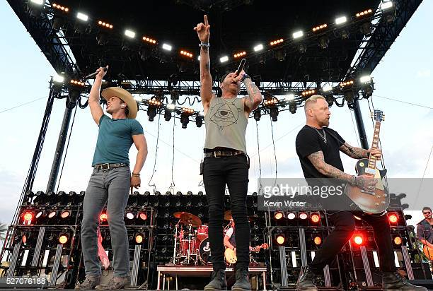 A Jay Popoff and Jeremy Popoff of the band Lit perform onstage with Dustin Lynch during 2016 Stagecoach California's Country Music Festival at Empire...