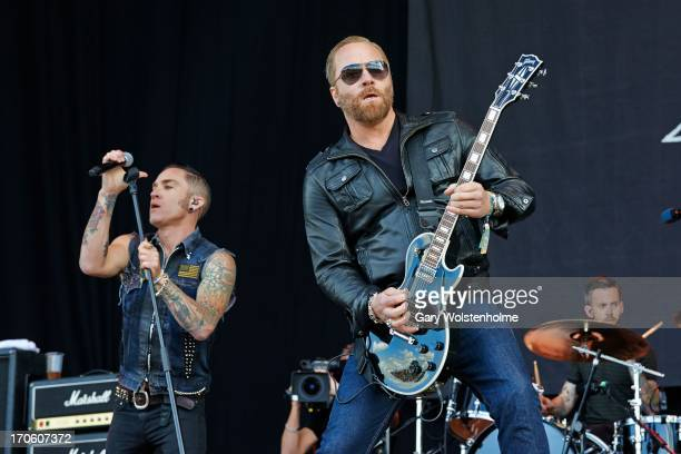 A Jay Popoff and Kevin Baldes of Lit performs on stage on Day 2 of Download Festival 2013 at Donnington Park on June 15 2013 in Donnington England