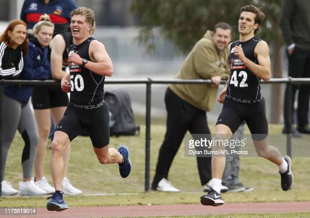 Jay Rantall and Finn Maginness complete the 2km time trial during the 2019 AFL Draft Combine at the Holden Centre on October 04 2019 in Melbourne...