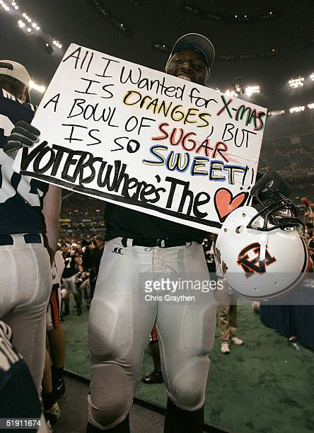 Jay Ratliff of the Auburn Tigers celebrates after defeating the Virginia Tech Hokies by a score of 1613 during the Nokia Sugar Bowl on January 3 2005...