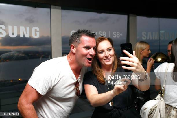 Jay Reeve is shown the features of the Samsung Galaxy S8 at the Samsung Galaxy Unpacked Launch at the Sugar Club at Sky City on March 30 2017 in...