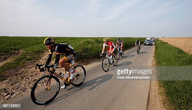 Jay Robert Thomson of South Africa, Florian Senechal and Maxime Daniel both of France and compete in the E3 Harelbeke Cycle Race on March 28, 2014 in...
