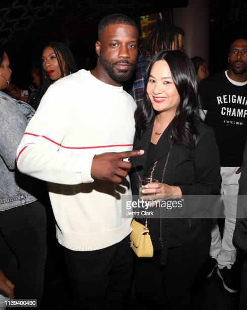 Jay Rock and ThuyAnh J Nguyen attend Jay Rock's Birthday at The Novo VIP Lounge on March 29 2019 in Los Angeles California