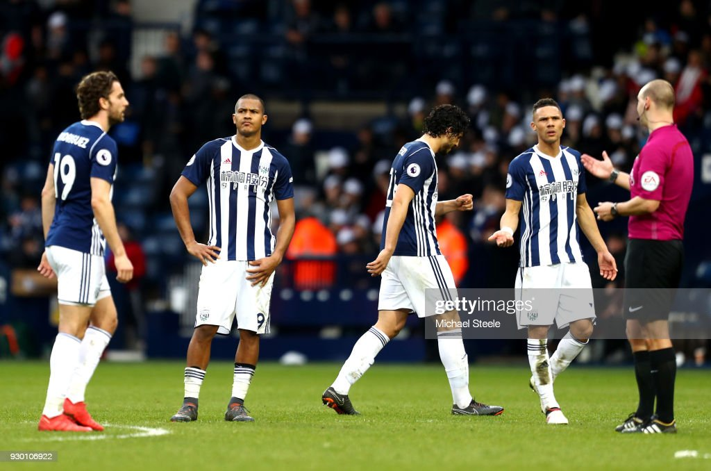 Jay Rodriguez, Jose Salomon Rondon, Ahmed El-Sayed Hegazi and Kieran Gibbs of West Bromwich Albion speak with the Match Referee on the full time whistle during the Premier League match between West Bromwich Albion and Leicester City at The Hawthorns on March 10, 2018 in West Bromwich, England.