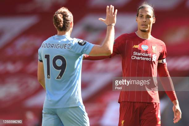 Jay Rodriguez of Burnley and Virgil van Dijk of Liverpool high five following the Premier League match between Liverpool FC and Burnley FC at Anfield...
