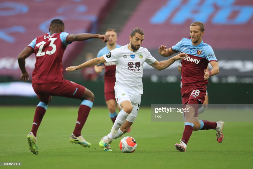 Jay Rodriguez of Burnley battles for possession with Issa Diop of ...