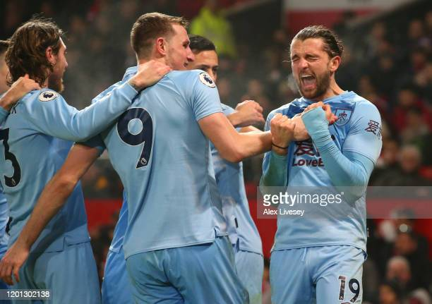 Jay Rodriguez of Burnley celebrates with Chris Wood and teammates after scoring his sides second goal during the Premier League match between...