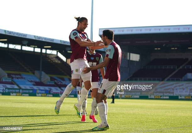 Jay Rodriguez of Burnley celebrates with teammates after scoring his sides first goal during the Premier League match between Burnley FC and Watford...