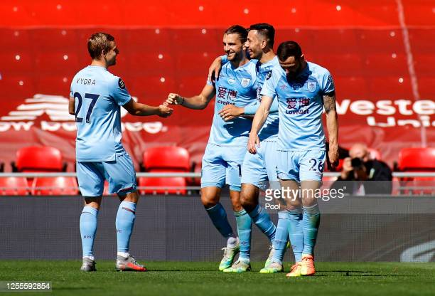Jay Rodriguez of Burnley celebrates with teammates after scoring his team's first goal during the Premier League match between Liverpool FC and...