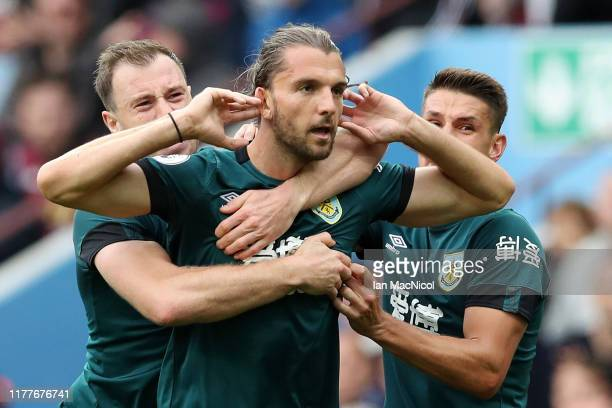 Jay Rodriguez of Burnley celebrates with teammates Ashley Barnes and Ashley Westwood after scoring his team's first goal during the Premier League...