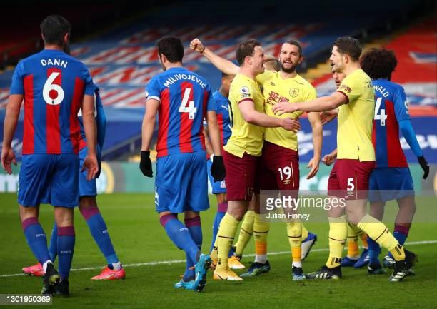 Jay Rodriguez of Burnley celebrates with teammates Ashley Barnes, and James Tarkowski after scoring his team's second goal during the Premier League...