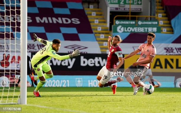 Jay Rodriguez of Burnley is fouled in the area by Ethan Ampadu of Sheffield United during the Carabao Cup second round match between Burnley and...