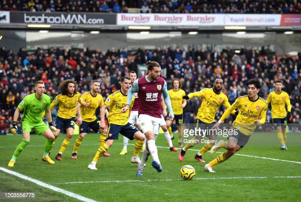 Jay Rodriguez of Burnley passes the ball as he is surrounded by Arsenal players during the Premier League match between Burnley FC and Arsenal FC at...
