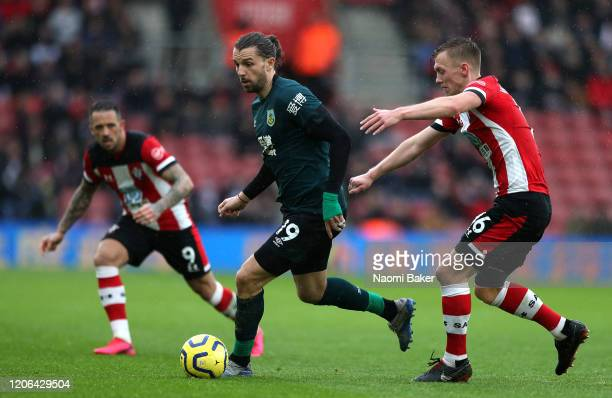 Jay Rodriguez of Burnley runs the ball with pressure from James WardProwse and Danny Ings of Southampton during the Premier League match between...