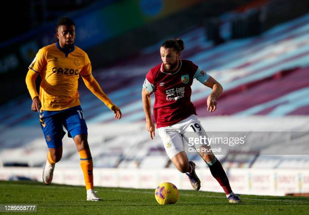 Jay Rodriguez of Burnley runs with the ball under pressure from Alex Iwobi of Everton during the Premier League match between Burnley and Everton at...