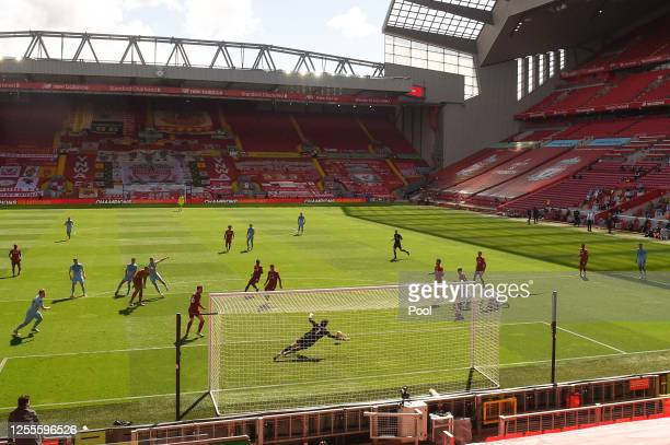 Jay Rodriguez of Burnley scores his team's first goal during the Premier League match between Liverpool FC and Burnley FC at Anfield on July 11 2020...