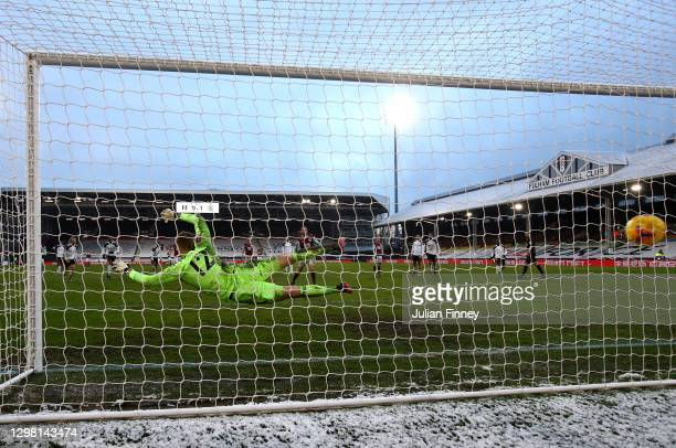 Jay Rodriguez of Burnley scores their sides second goal from the penalty spot past Marek Rodak of Fulham during The Emirates FA Cup Fourth Round...