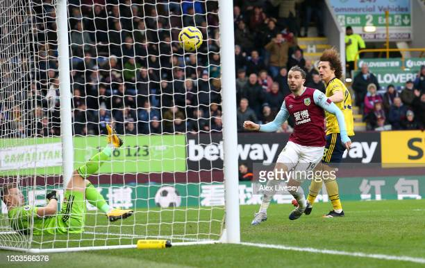 Jay Rodriguez of Burnley shoots which hits the crossbar during the Premier League match between Burnley FC and Arsenal FC at Turf Moor on February...