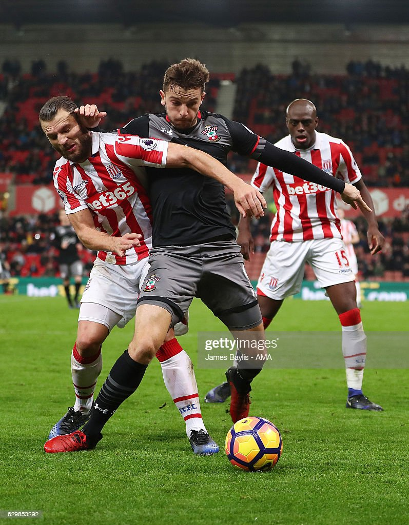 Jay Rodriguez of Southampton and Erik Pieters of Stoke City during the Premier League match between Stoke City and Southampton at Bet365 Stadium on December 14, 2016 in Stoke on Trent, England.