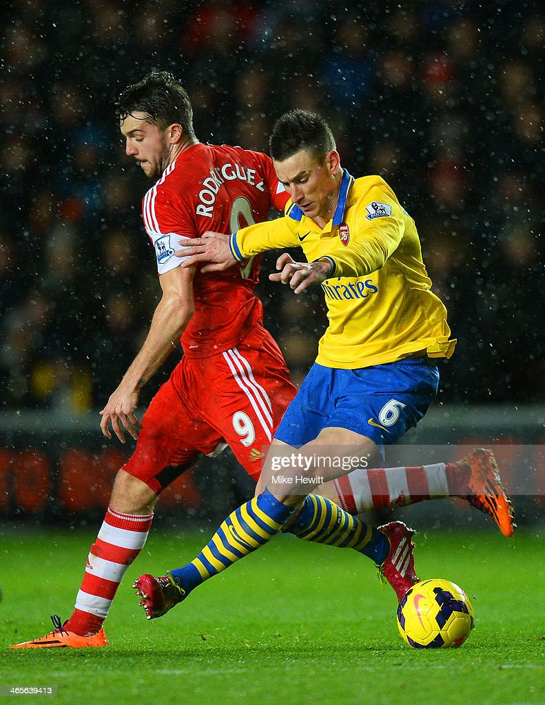 Jay Rodriguez of Southampton and Laurent Koscielny of Arsenal compete for the ball during the Barclays Premier League match between Southampton and Arsenal at St Mary's Stadium on January 28, 2014 in Southampton, England.