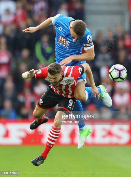 Jay Rodriguez of Southampton and Simon Francis of AFC Bournemouth battle to win a header during the Premier League match between Southampton and AFC...