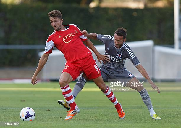 Jay Rodriguez of Southampton and Tomas Sivok of Bestikas compete for the ball during the preseason friendly match between Southampton FC and Besiktas...