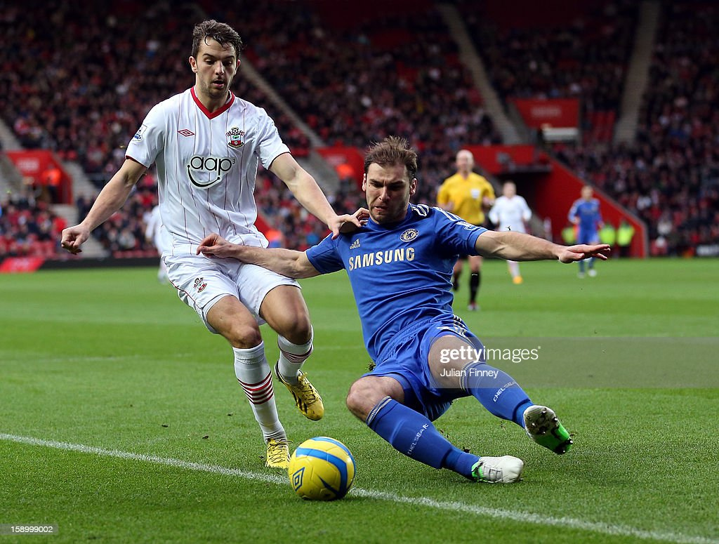 Jay Rodriguez of Southampton battles with Branislav Ivanovic of Chelsea during the FA Cup Third Round match between Southampton and Chelsea at St Mary's Stadium on January 5, 2013 in Southampton, England.