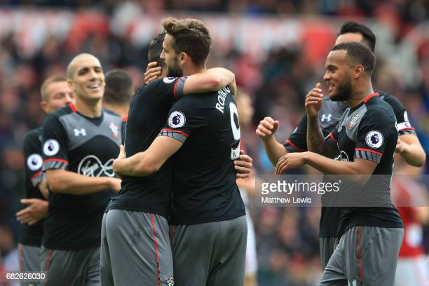 Jay Rodriguez of Southampton celebrates scoring his sides first goal with his Southampton team mates during the Premier League match between...