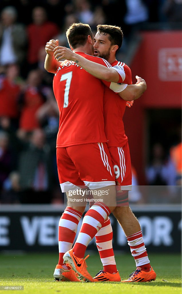 Jay Rodriguez (R) of Southampton celebrates with teammate Rickie Lambert after scoring the opening goal during the Barclays Premier League match between Southampton and Newcastle United at St Mary's Stadium on March 29, 2014 in Southampton, England.