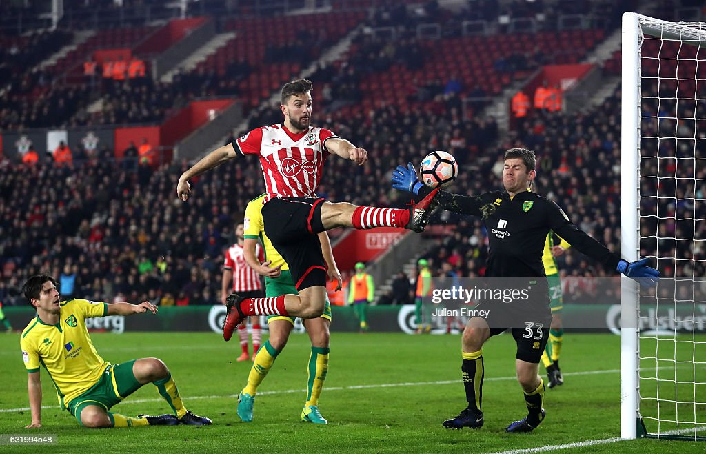 Jay Rodriguez of Southampton challenges for the ball with Michael McGovern of Norwich City during The Emirates FA Cup Third Round Replay match between Southampton and Norwich City at St Mary's Stadium on January 18, 2017 in Southampton, England.
