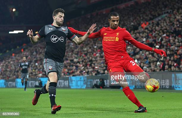 Jay Rodriguez of Southampton closes down Joel Matip of Liverpool during the EFL Cup SemiFinal Second Leg match between Liverpool and Southampton at...