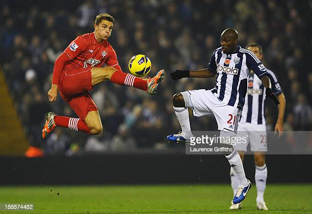 Jay Rodriguez of Southampton competes with Youssuf Mulumbu of West Bromwich Albion during the Barclays Premier League match between West Bromwich...
