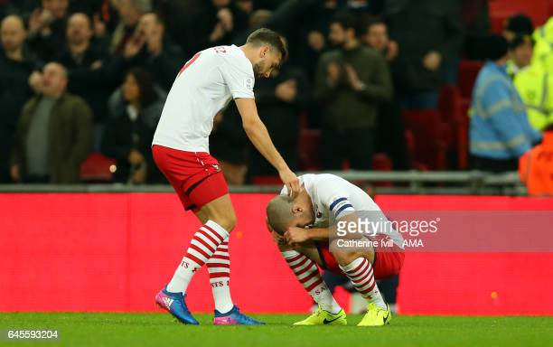 Jay Rodriguez of Southampton consoles a dejected Oriol Romeu of Southampton during the EFL Cup Final match between Manchester United and Southampton...