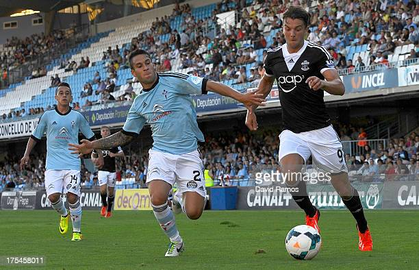 Jay Rodriguez of Southampton duels for the ball with Hugo Mallo of RC Celta de Vigo during a friendly match between RC Celta de Vigo and Southampton...