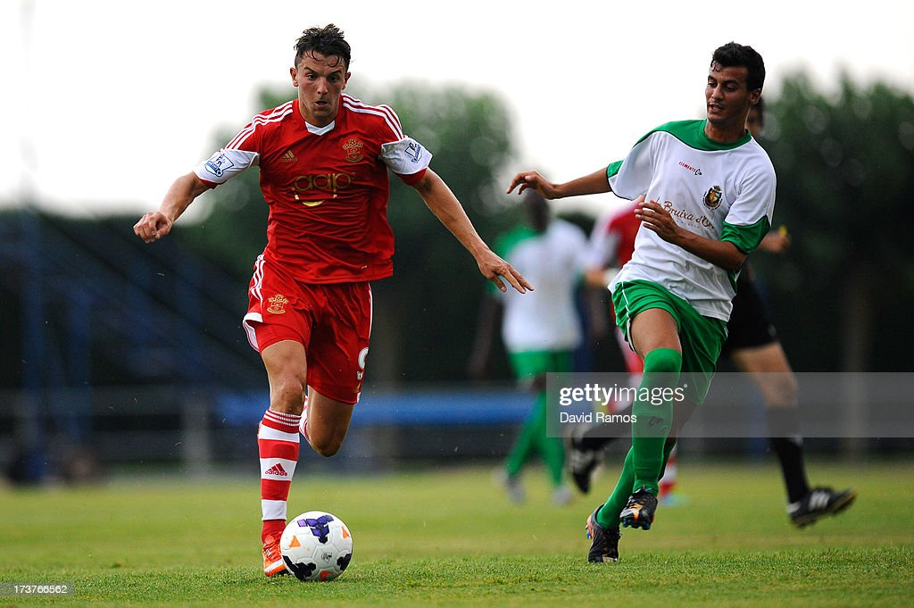 Jay Rodriguez of Southampton duels for the ball with Marc Garcia of UE Llagostera during a friendly match between Southampton FC and UE Llagostera at the Josep Pla i Arbones Stadium on July 17, 2013 in Girona, Spain.