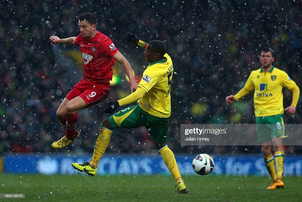 Jay Rodriguez of Southampton goes past Sebastien Bassong of Norwich City during the Barclays Premier League match between Norwich City and Southampton at Carrow Road on March 9, 2013 in Norwich, England.