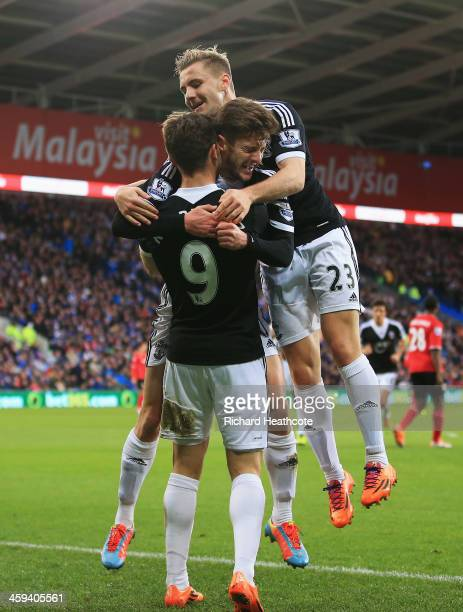 Jay Rodriguez of Southampton is congratulated by Adam Lallana and Luke Shaw after his opening goal during the Barclays Premier League match between...