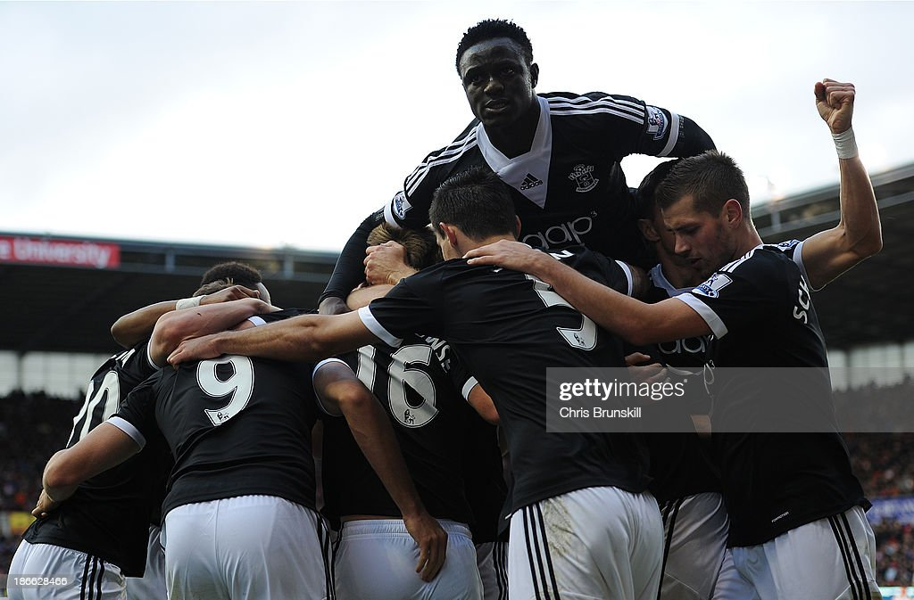 Jay Rodriguez of Southampton is mobbed by his team-mates after scoring his side's first goal during the Barclays Premier League match between Stoke City and Southampton on November 02, 2013 in Stoke on Trent, England.