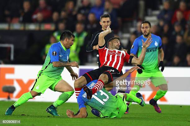 Jay Rodriguez of Southampton is tackled by Andrea Ranocchia of Internazionale during the UEFA Europa League Group K match between Southampton FC and...