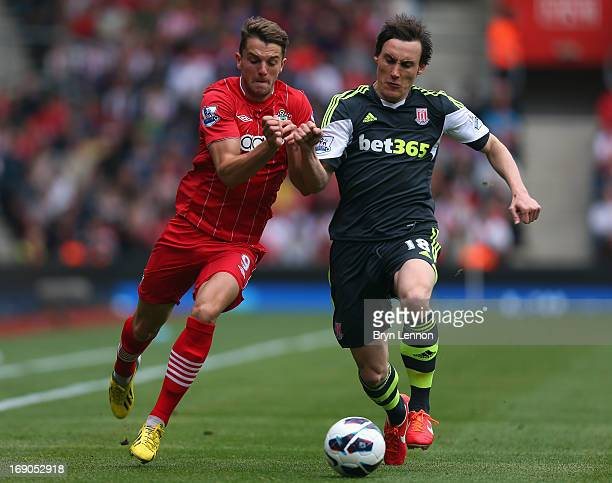 Jay Rodriguez of Southampton is tackled by Dean Whitehead of Stoke City during the Barclays Premier League match between Southampton and Stoke City...