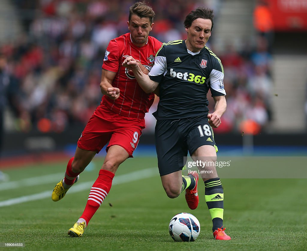Jay Rodriguez of Southampton is tackled by Dean Whitehead of Stoke City during the Barclays Premier League match between Southampton and Stoke City at St Mary's Stadium on May 19, 2013 in Southampton, England.