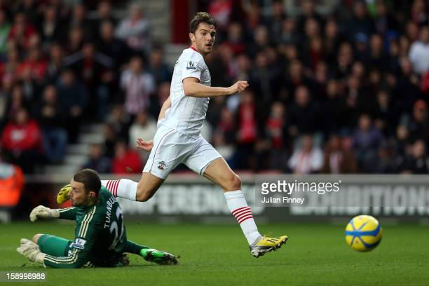 Jay Rodriguez of Southampton scores the first goal past Ross Turnbull of Chelsea during the FA Cup Third Round match between Southampton and Chelsea...