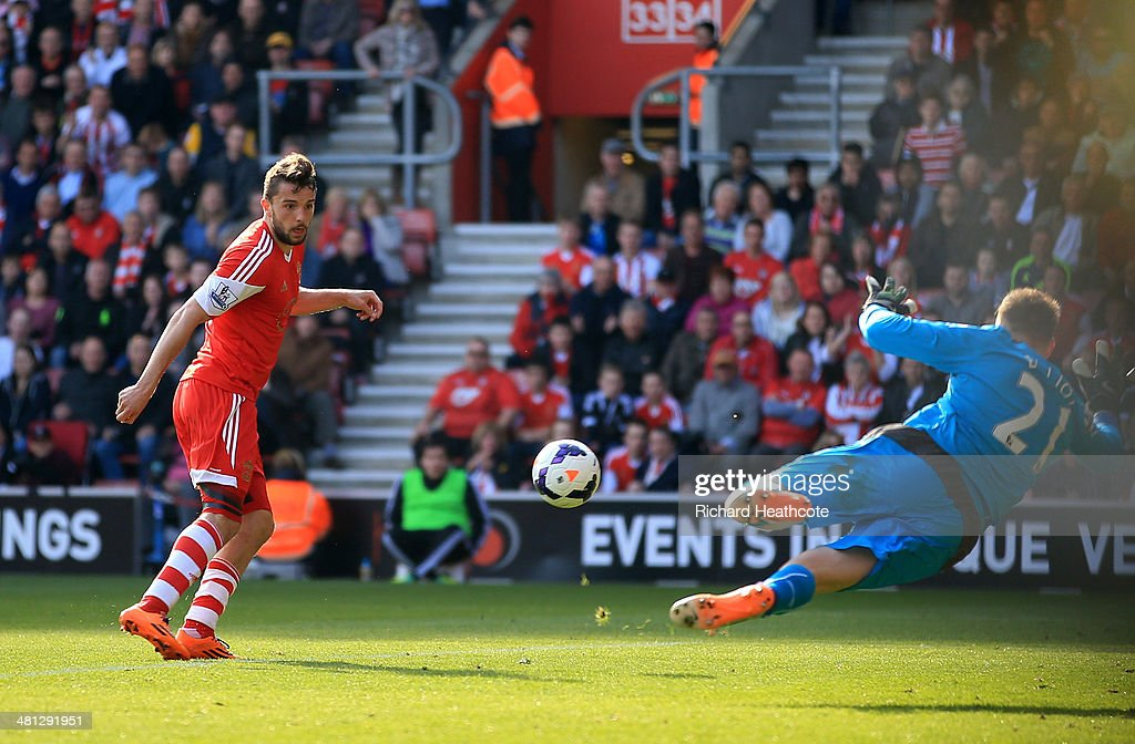 Jay Rodriguez of Southampton scores the opening goal past goalkeeper Robert Elliot of Newcastle United during the Barclays Premier League match between Southampton and Newcastle United at St Mary's Stadium on March 29, 2014 in Southampton, England.