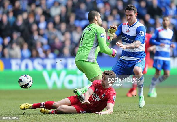 Jay Rodriguez of Southampton scores the opening goal past keeper Adam Federici of Reading during the Barclays Premier League match between Reading...
