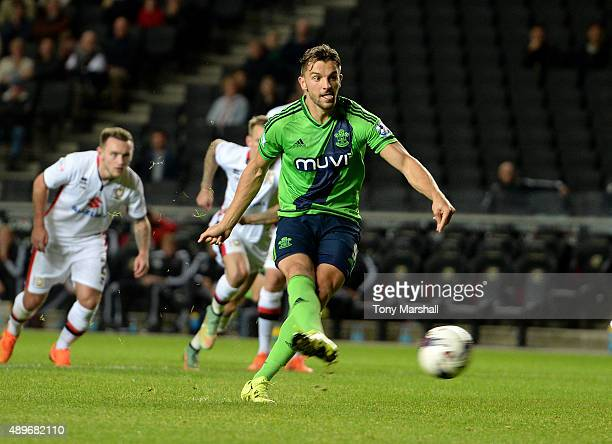 Jay Rodriguez of Southampton scoring their fourth goal from the penalty spot during the Capital One Cup third round match between MK Dons and...