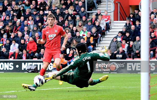 Jay Rodriguez of Southampton shoots past goalkeeper Petr Cech of Chelsea to score the opening goal during the Barclays Premier League match between...